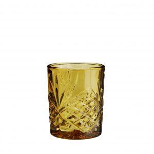 Gelbes geschliffenes Whiskeyglas